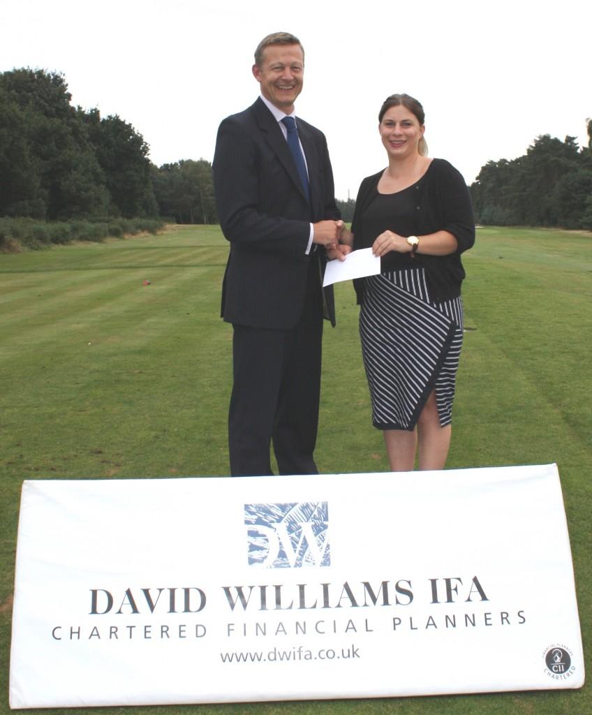 David Williams IFA managing director Nick Beal with Aimee Stein of DEBRA